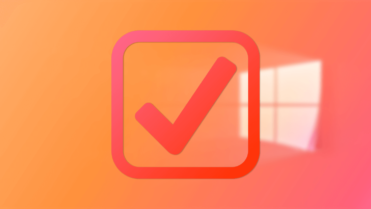 Orange-checkmark-over-windows-wallpaper-050820